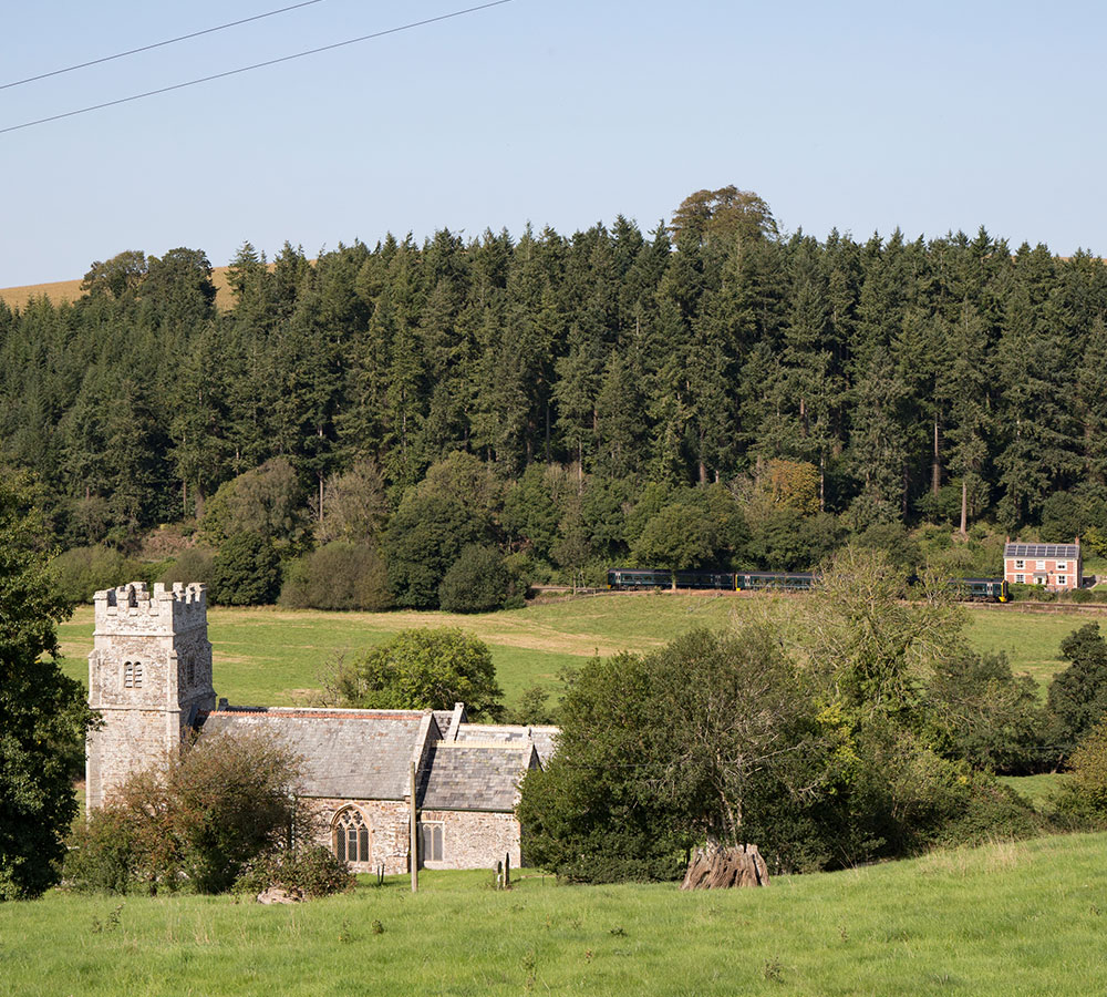 Eggesford Church with Tarka Line train behind