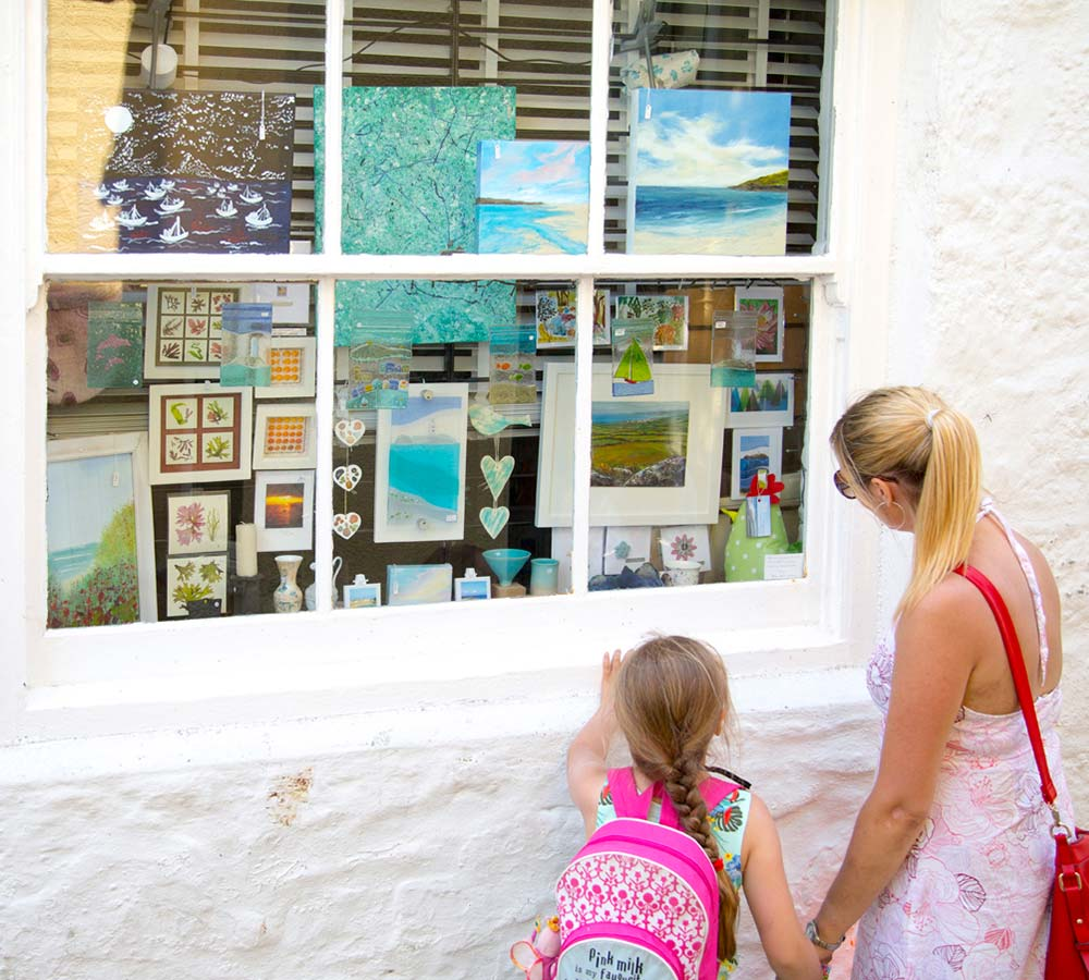 Mother and daughter look in gallery window in St Ives