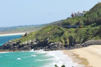 GWR train arriving into St Ives with beach views