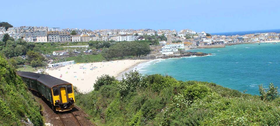 Train with Porthminster Beach and St Ives in background