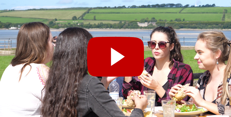 Thumbnail image from video with play button - click to watch one-minute video on YouTube