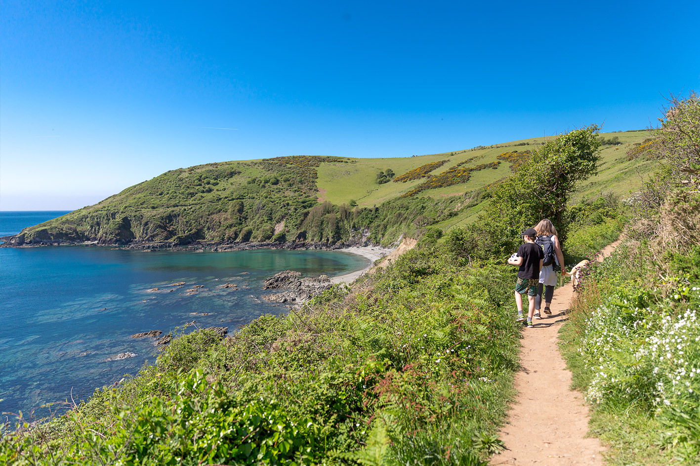 Family walking the South West Coast Path between Looe and Polperro