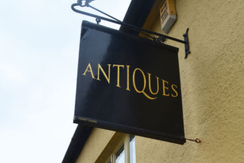 Antiques shop sign in Honiton