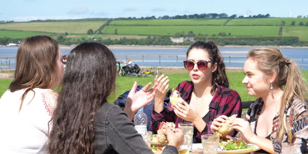Young people eating lunch at Fremington Quay Cafe
