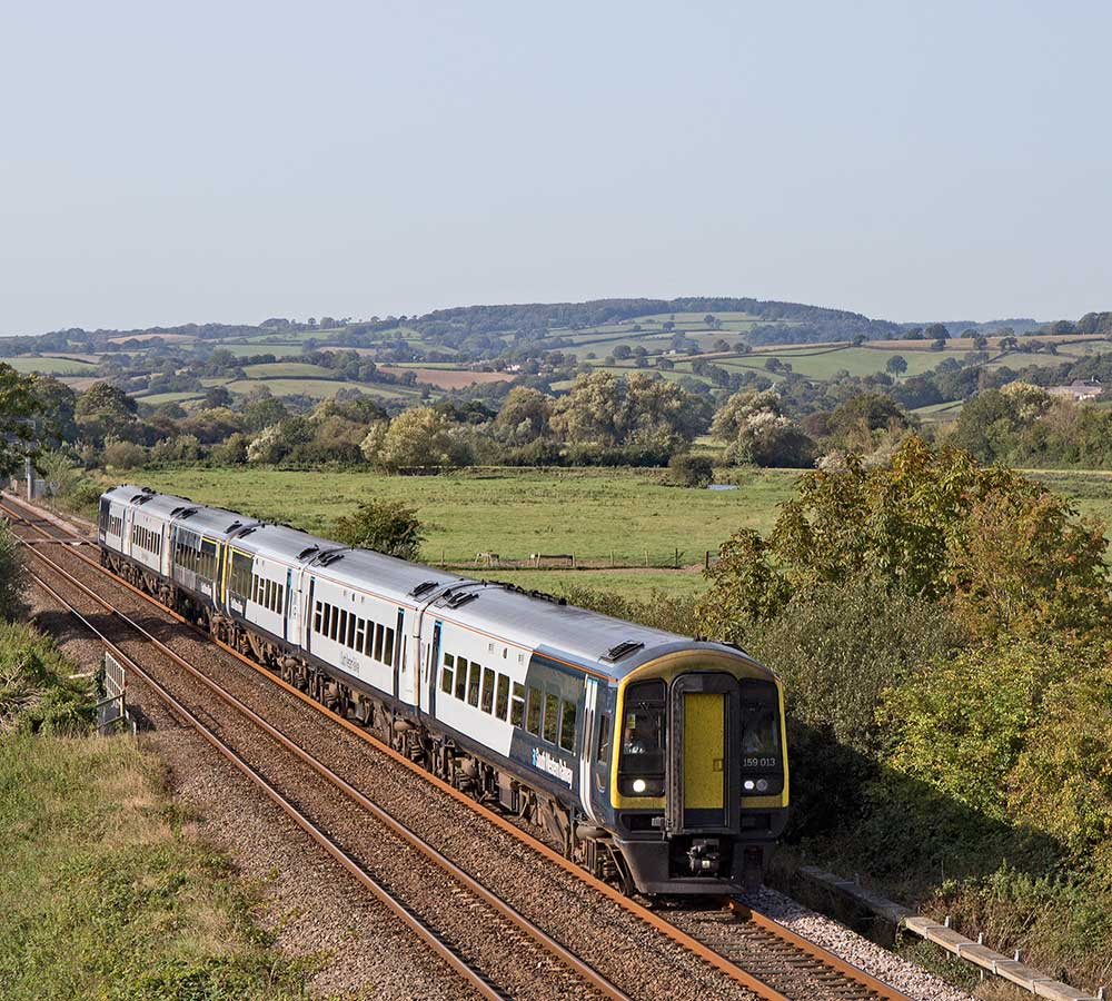 SWR train in landscape on East Devon Line