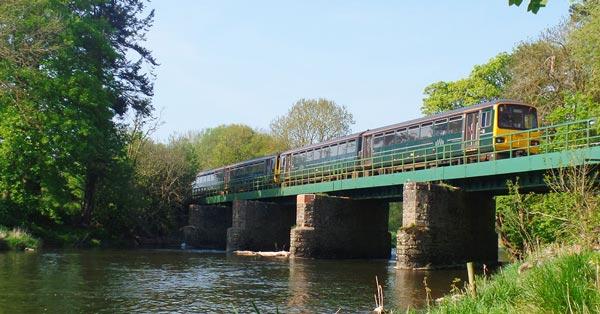 Train on bridge on Tarka Line - photo by Mark Lynam