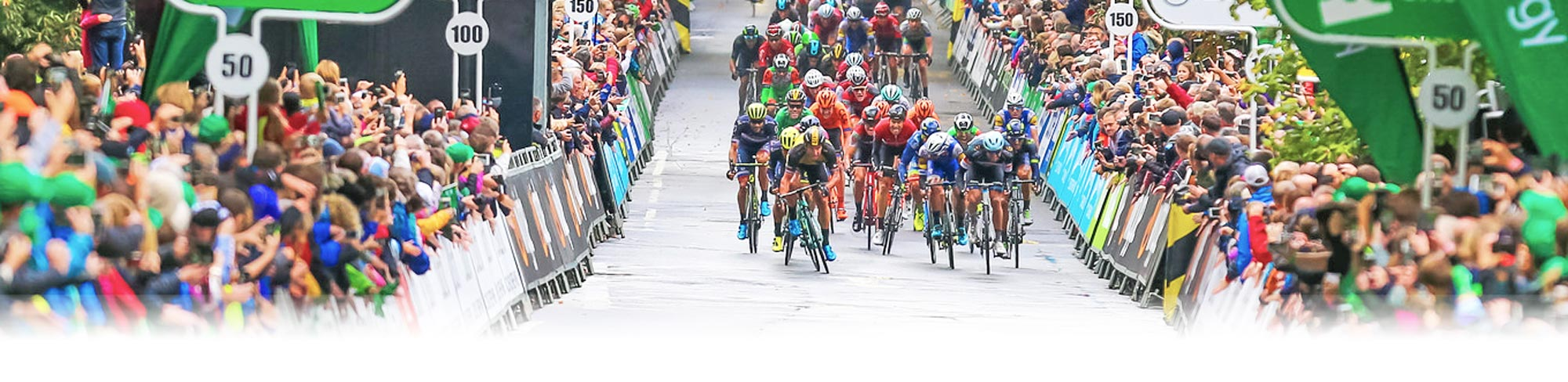 Cyclists cycling towards camera in the 2017 Tour of Britain - photo courtesy of Tour of Britain / Sweetspot