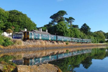 Lelant station with train reflected in water