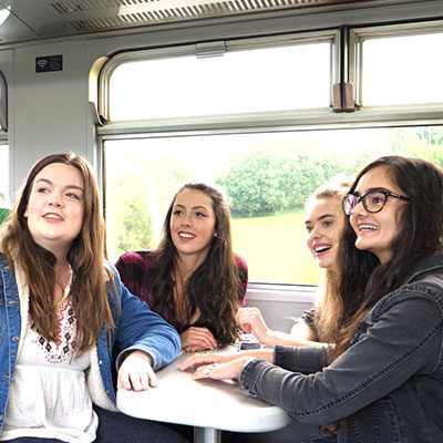 Group of passengers looking at the view out of the train window